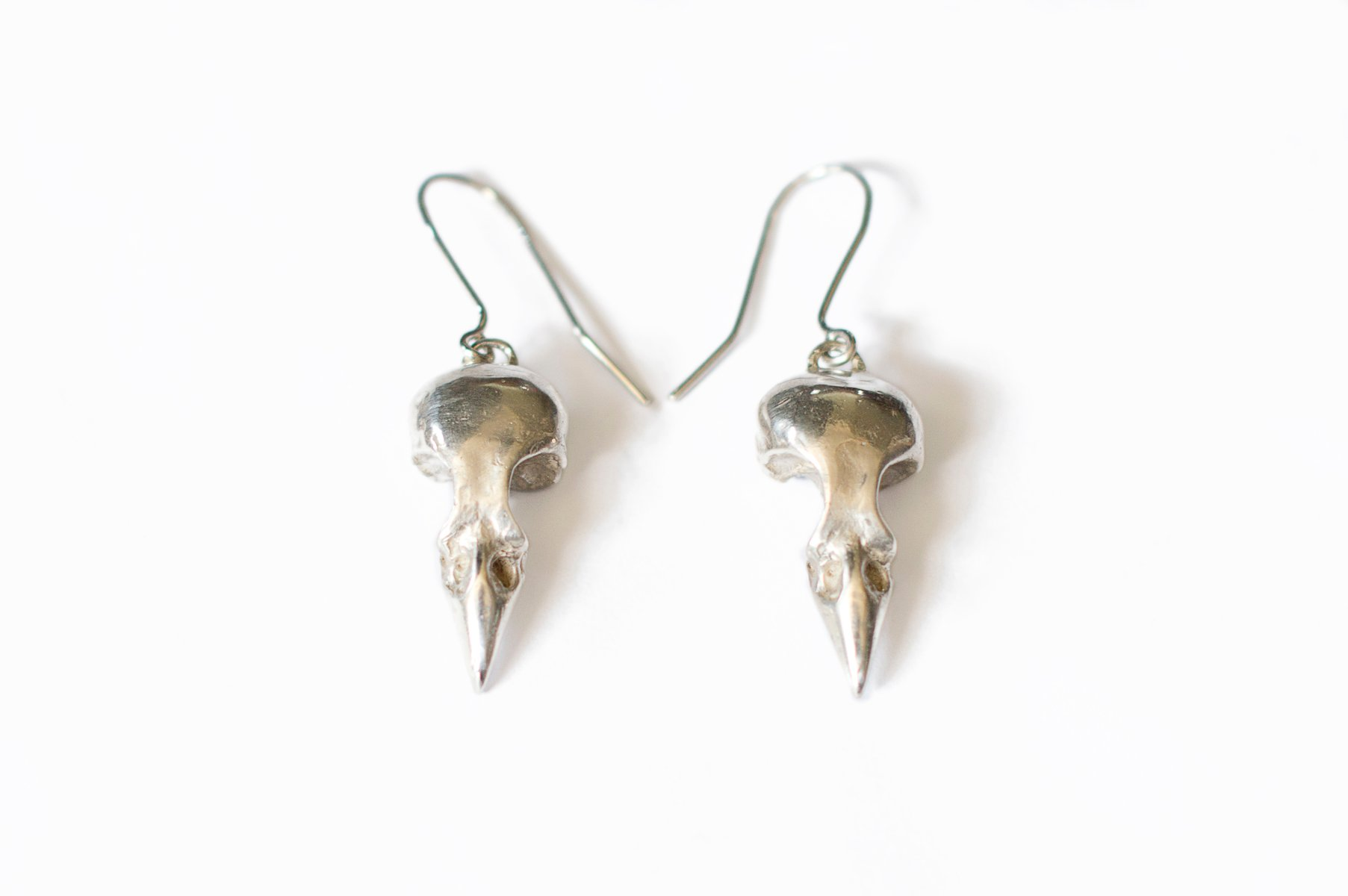 sterling silver bird skull earring